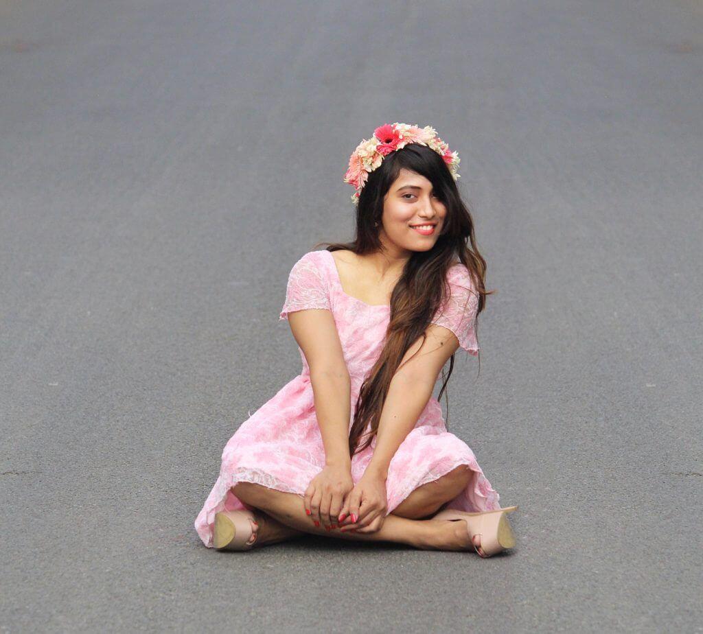 Shrizan Sitting Smiling In Pink Dress