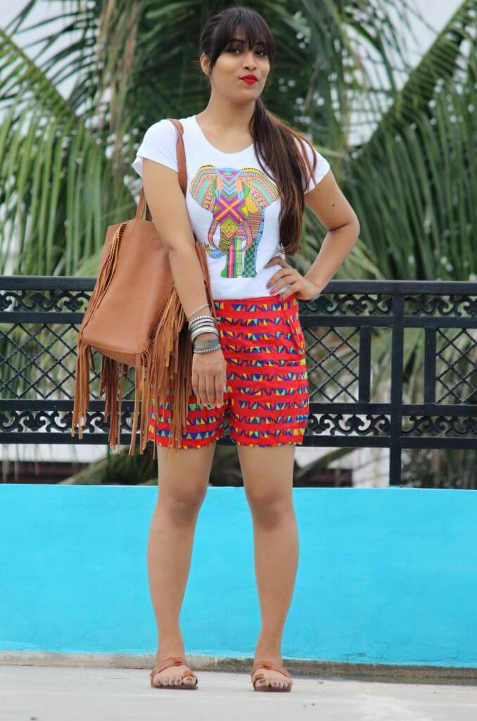 Shrizan White Elephant Printed Tee Red Printed Shorts Looking Forward Slight Smile