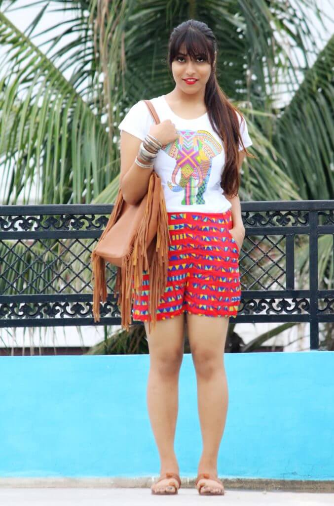 Shrizan Wearing White Tee And Red Printed Shorts