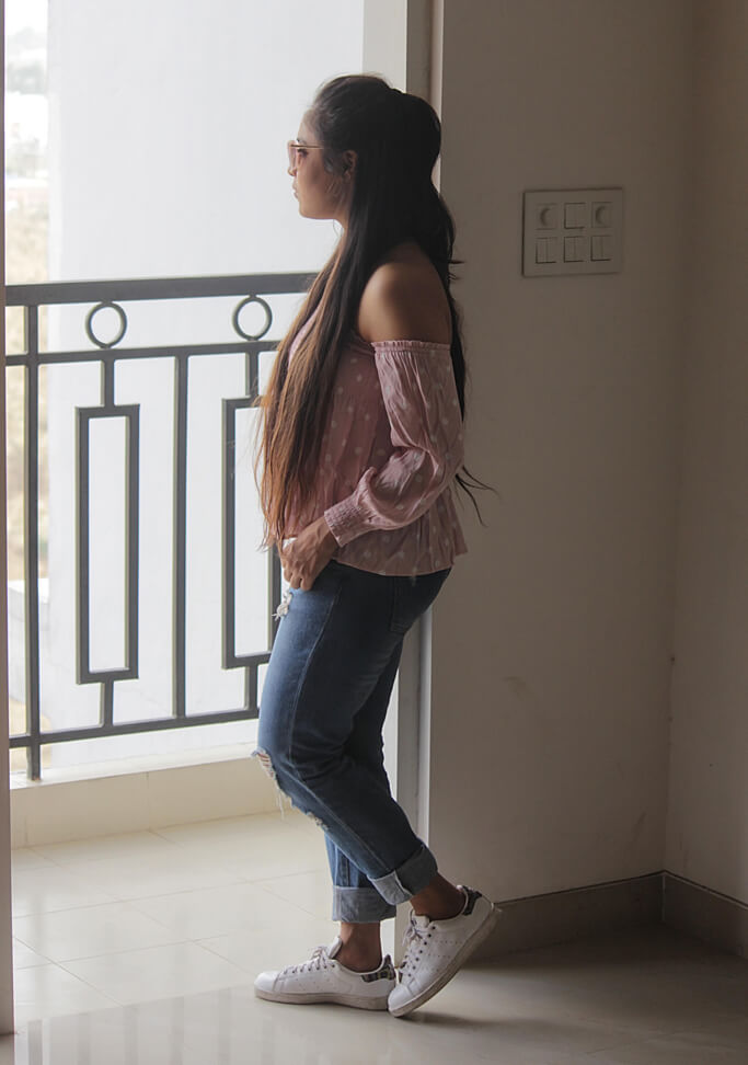 In the 2nd look, I wore same jeans as I wore in the previous look, I matched it up with off shoulder pink top, which has polka dot print all over the top. These days off shoulder tops are in trend. They have the modern touch with feminine feel and looks cute on every girl. I only change my hairstyle, I made a high ponytail with half section. For making this look funkier, I added this pink wayfarer. What's better than white sneakers for a casual look, so I had to take my stansmith to complete the look.