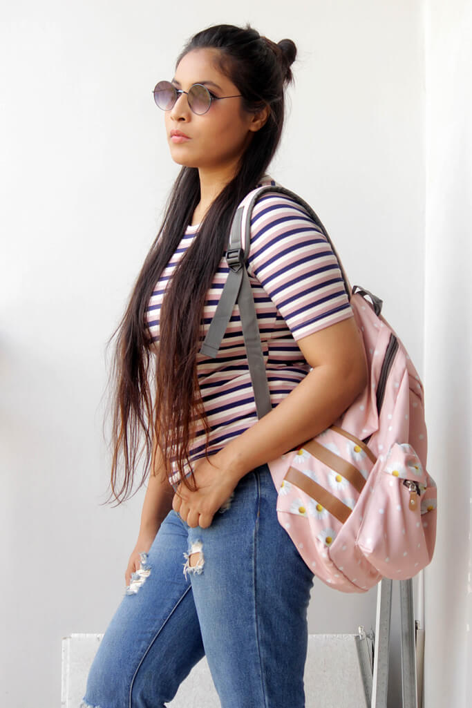 I want to make some very casual styles. I wore my favourite rugged jeans only with peach & blue stripe t-shirt which I bought from Forever21 and matched with white Adidas Stansmith sneakers. Now you all must be thinking, where is Polka dot print in this look. Come on, guys for college lookbook how can we complete the whole look without a backpack? Yes, my darlings backpack!! This baby pink cute polka dot print bag is my favourite gear to take on & it goes with my outfit so well.