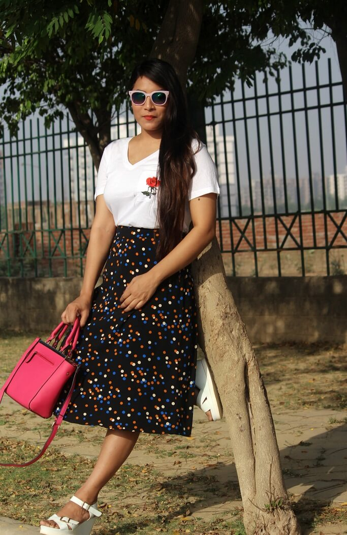 I want this look casual but sophisticated & fun, and if you're talking about polka dots, this print has it all. For this look I bought a very cool look mixed colour polka dot skater skirt and paired it with white classic V-neck tshirt which has cute rose patch on side. I love these kind of solid colour t shirts. They gelled with all kinds of clothes if you wanna match with. I wore this white platform heel which give a hype to the outfit.
