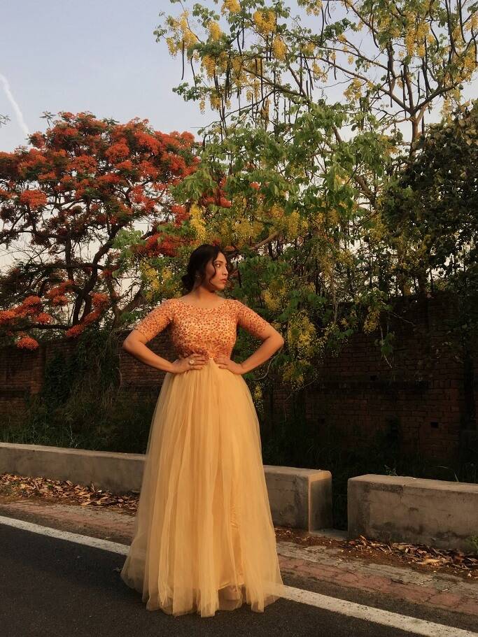 Shrizan Posing Golden Gown Trees In Background Wedding Dress Ideas