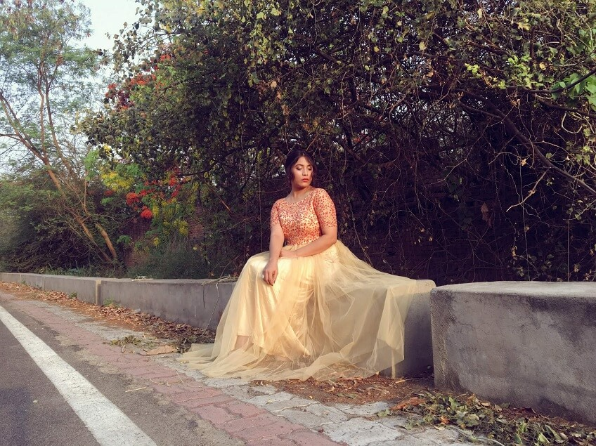 Shrizan Sitting Posing Golden Gown Wedding Dress Idea